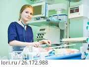 Купить «Female doctor portrait in front of intensive care unit for newborn infant baby», фото № 26172988, снято 21 февраля 2017 г. (c) Дмитрий Калиновский / Фотобанк Лори