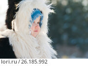 Купить «Little girl in a fur coat with a hood in a winter park», фото № 26185992, снято 1 декабря 2016 г. (c) Сергей Лабутин / Фотобанк Лори
