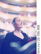 Купить «Woman in auditorium of teatre», фото № 26186408, снято 20 июля 2019 г. (c) Яков Филимонов / Фотобанк Лори