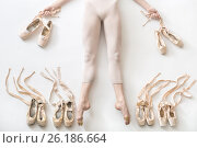 Купить «Ballerina lies in studio», фото № 26186664, снято 17 апреля 2017 г. (c) Andriy Bezuglov / Фотобанк Лори