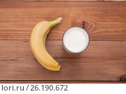 Glass of milk and bananas on a wooden background. View from above . Стоковое фото, фотограф Владимир Семенчук / Фотобанк Лори