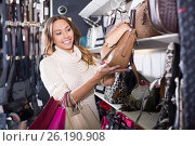 Купить «Excited young female shopping new handbag in shop», фото № 26190908, снято 19 января 2019 г. (c) Яков Филимонов / Фотобанк Лори
