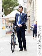 Купить «Young businessmen with a bike», фото № 26207888, снято 4 апреля 2015 г. (c) Sergey Nivens / Фотобанк Лори