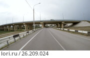 Купить «The car is driving along the highway. Rear view.», видеоролик № 26209024, снято 30 апреля 2017 г. (c) Денис Дряшкин / Фотобанк Лори