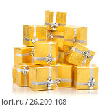 Купить «A pile of gold gifts on white», фото № 26209108, снято 18 августа 2012 г. (c) Tatjana Romanova / Фотобанк Лори
