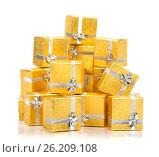 A pile of gold gifts on white, фото № 26209108, снято 18 августа 2012 г. (c) Tatjana Romanova / Фотобанк Лори