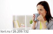 Купить «happy woman drinking tea or coffee at home», видеоролик № 26209132, снято 21 сентября 2019 г. (c) Syda Productions / Фотобанк Лори