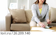Купить «woman with money, papers and calculator at home», видеоролик № 26209140, снято 22 августа 2019 г. (c) Syda Productions / Фотобанк Лори