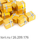 Купить «Close up of a pile of gold gifts on white», фото № 26209176, снято 18 августа 2012 г. (c) Tatjana Romanova / Фотобанк Лори