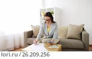 Купить «woman with money, papers and calculator at home», видеоролик № 26209256, снято 22 августа 2019 г. (c) Syda Productions / Фотобанк Лори