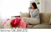 Купить «happy woman drinking tea or coffee at home», видеоролик № 26209272, снято 20 сентября 2019 г. (c) Syda Productions / Фотобанк Лори