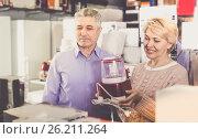Купить «Man and woman 47-57 years old are buying in shop of household ap», фото № 26211264, снято 22 августа 2019 г. (c) Яков Филимонов / Фотобанк Лори