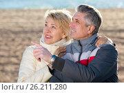 Купить «Mature couple walks outdoors and point by hand», фото № 26211280, снято 18 августа 2018 г. (c) Яков Филимонов / Фотобанк Лори