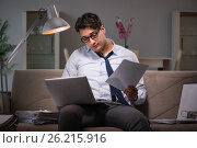 Купить «The businessman workaholic working late at home», фото № 26215916, снято 12 января 2017 г. (c) Elnur / Фотобанк Лори