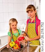 Купить «Fruit and vegetable wash of woman on kitchen home.», фото № 26218752, снято 5 сентября 2013 г. (c) Gennadiy Poznyakov / Фотобанк Лори