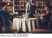 Couple reading menu in a restaurant, фото № 26228852, снято 17 апреля 2017 г. (c) Andrejs Pidjass / Фотобанк Лори