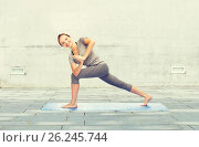 Купить «woman making yoga low angle lunge pose on mat», фото № 26245744, снято 13 ноября 2015 г. (c) Syda Productions / Фотобанк Лори