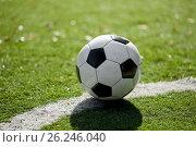 soccer ball on football field. Стоковое фото, фотограф Syda Productions / Фотобанк Лори