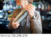 Купить «close up of bartender with cocktail shaker at bar», фото № 26246216, снято 7 февраля 2017 г. (c) Syda Productions / Фотобанк Лори