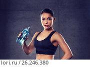 Купить «woman drinking water from bottle in gym», фото № 26246380, снято 12 декабря 2015 г. (c) Syda Productions / Фотобанк Лори