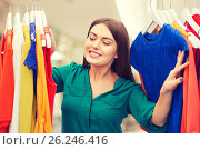 Купить «happy woman choosing clothes at home wardrobe», фото № 26246416, снято 19 февраля 2016 г. (c) Syda Productions / Фотобанк Лори