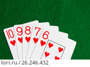 Купить «poker hand of playing cards on green casino cloth», фото № 26246432, снято 15 марта 2017 г. (c) Syda Productions / Фотобанк Лори