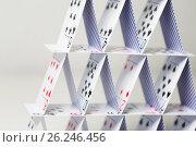 Купить «house of playing cards over white background», фото № 26246456, снято 15 марта 2017 г. (c) Syda Productions / Фотобанк Лори