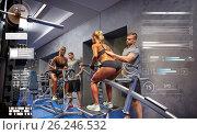 Купить «man and woman flexing muscles on gym machine», фото № 26246532, снято 19 апреля 2015 г. (c) Syda Productions / Фотобанк Лори