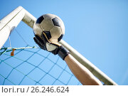 goalkeeper with ball at football goal over sky. Стоковое фото, фотограф Syda Productions / Фотобанк Лори