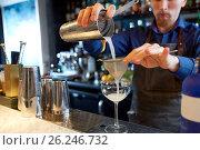 Купить «bartender with shaker preparing cocktail at bar», фото № 26246732, снято 7 февраля 2017 г. (c) Syda Productions / Фотобанк Лори