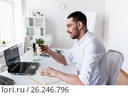 Купить «businessman with smartphone and notebook at office», фото № 26246796, снято 9 марта 2017 г. (c) Syda Productions / Фотобанк Лори