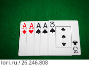 Купить «poker hand of playing cards on green casino cloth», фото № 26246808, снято 15 марта 2017 г. (c) Syda Productions / Фотобанк Лори