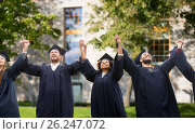 Купить «happy students or bachelors celebrating graduation», фото № 26247072, снято 24 сентября 2016 г. (c) Syda Productions / Фотобанк Лори