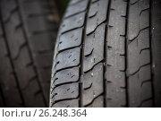 Купить «Worn-out tires close up», фото № 26248364, снято 15 июня 2016 г. (c) Astroid / Фотобанк Лори