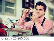 Купить «Joiner working in workshop», фото № 26265656, снято 8 апреля 2017 г. (c) Яков Филимонов / Фотобанк Лори