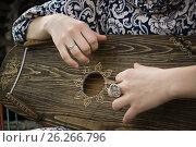 Купить «Gusli folk musical instrument in woman hands», фото № 26266796, снято 2 мая 2017 г. (c) Дмитрий Черевко / Фотобанк Лори