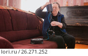 Купить «An elderly woman prepares the device for measuring blood pressure», фото № 26271252, снято 23 мая 2019 г. (c) Константин Шишкин / Фотобанк Лори
