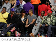 Купить «Celebrities at the Los Angeles Clippers game. The Golden State Warriors defeated the Los Angeles Clippers by the final score of 115-112 at Staples Center...», фото № 26278652, снято 20 февраля 2016 г. (c) age Fotostock / Фотобанк Лори