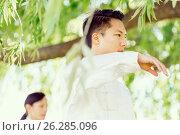 Купить «Handsome man practicing thai chi», фото № 26285096, снято 19 декабря 2014 г. (c) Sergey Nivens / Фотобанк Лори