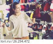 Купить «Woman choosing new knit cap», фото № 26294472, снято 22 ноября 2016 г. (c) Яков Филимонов / Фотобанк Лори