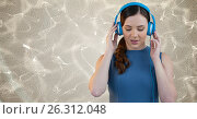 Купить «Young woman listening to music on headphones», фото № 26312048, снято 19 июля 2019 г. (c) Wavebreak Media / Фотобанк Лори