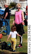 Купить «Gwen Stefani watches her son Zuma Rossdale play flag football at the park. Her two other sons, Kingston and Apollo, attended as well. The whole family...», фото № 26314940, снято 6 февраля 2016 г. (c) age Fotostock / Фотобанк Лори