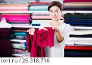 Купить «Woman testing fabric quality», фото № 26318716, снято 4 января 2017 г. (c) Яков Филимонов / Фотобанк Лори