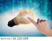 Купить «Hand Touching Light bulb fingerprint», фото № 26320688, снято 17 февраля 2019 г. (c) Wavebreak Media / Фотобанк Лори