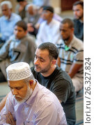 Купить «Listening to an Iman's sermon or Khutbah, Muslim men bow in reverence during Friday afternoon prayers at religious services at an Anaheim, CA, mosque.», фото № 26327824, снято 23 октября 2016 г. (c) age Fotostock / Фотобанк Лори