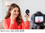 Купить «woman with eyebrow pencil recording video at home», фото № 26335808, снято 22 декабря 2016 г. (c) Syda Productions / Фотобанк Лори