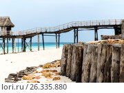 Купить «stilt bridge to bungalow hut on tropical beach», фото № 26335880, снято 24 февраля 2017 г. (c) Syda Productions / Фотобанк Лори