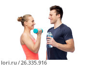 Купить «sportive man and woman with dumbbell and water», фото № 26335916, снято 2 марта 2017 г. (c) Syda Productions / Фотобанк Лори