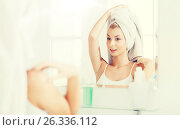 Купить «happy young woman with towel at mirror in bathroom», фото № 26336112, снято 13 февраля 2016 г. (c) Syda Productions / Фотобанк Лори