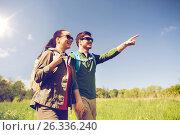 Купить «happy couple with backpacks hiking outdoors», фото № 26336240, снято 27 мая 2016 г. (c) Syda Productions / Фотобанк Лори